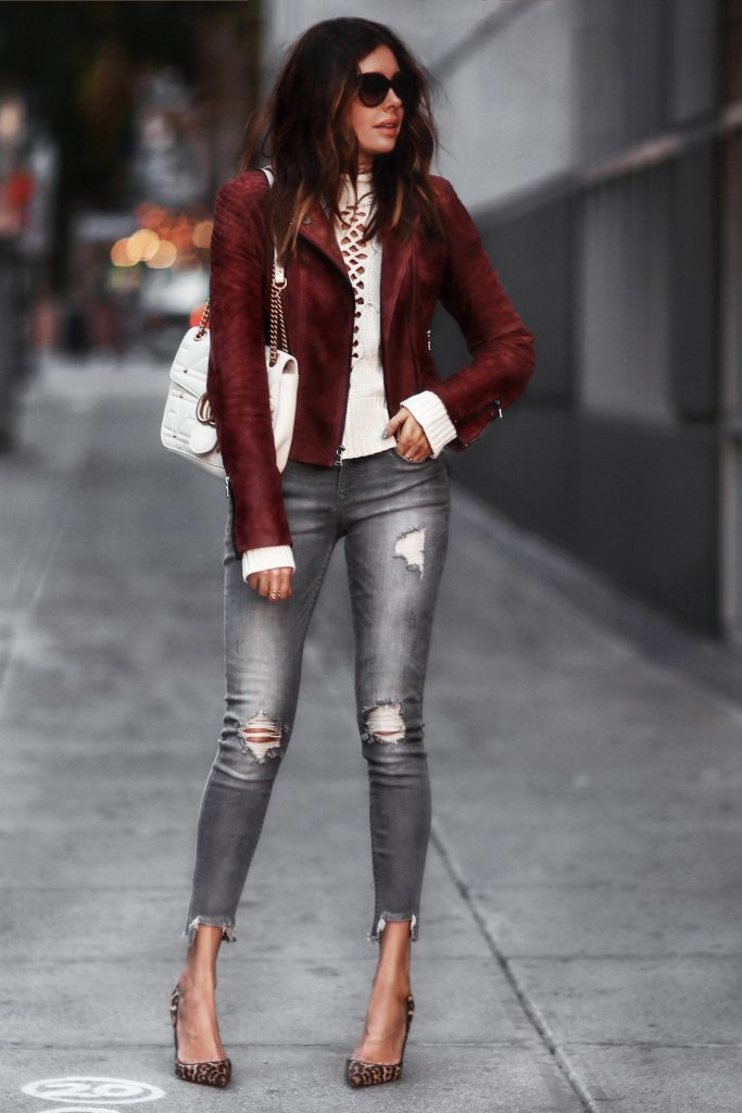Erica Hoida is rocking another hot fall trend; the suede jacket! Pair a jacket such as this with distressed jeans and heels to capture the edgy, casual vibes which Erica has mastered! Suede Jacket/Jeans/Sweater: Express, Shoes: Christian Louboutin, Bag: Gucci.