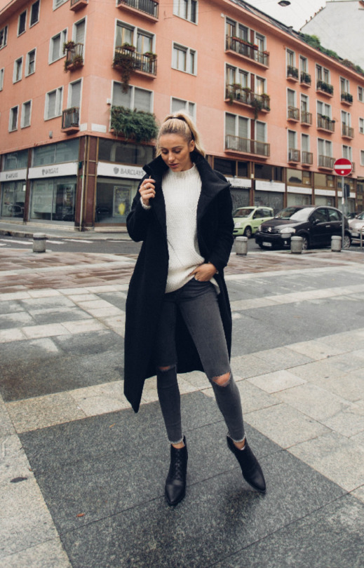Sendi Skopljak is killing this sleek fall outfit, in a black collared coat matched with a white sweater for a fabulous contrast. Wear this style with distressed grey jeans and a pair of pointed Chelsea boots to capture this look. Sweater/Coat: Zara, Jeans: Gina tricot, Shoes: Senso, Sunglasses: Chanel, Bag: Givenchy.