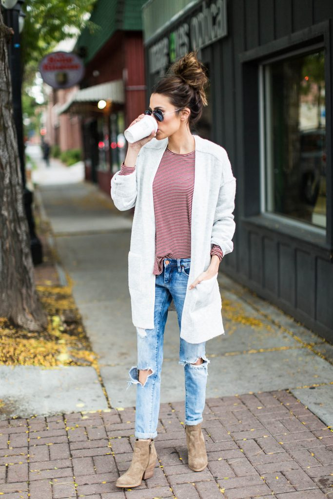 Christine Andrew brings it back to basics in a striped tee, distressed jeans, and a cosy white cardigan. An outfit like this works best worn with leather or suede boots, however can also be worn with sneakers or even heels! Outfit: ILY Couture.