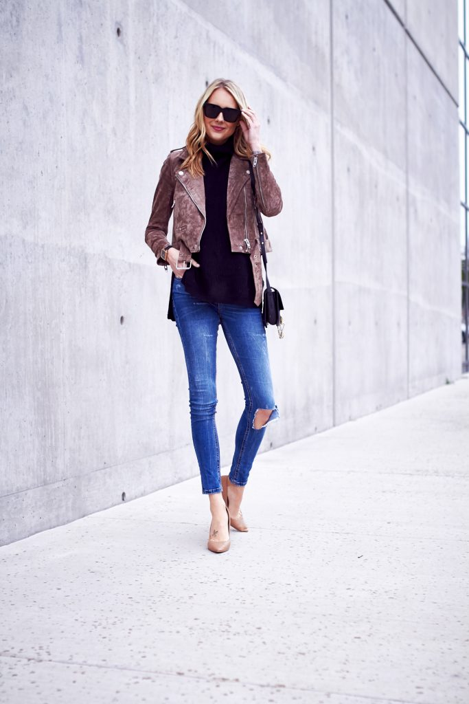 Amy Jackson looks smart and sophisticated in this outfit, consisting of a black turtleneck and jeans, brought together with a beautiful suede jacket. A jacket such as this is a must have this fall, and will add that edge of glamour to even the most casual of styles. Jacket: BLANKNYC, Heels: Nordstrom, Bag: Chloe.
