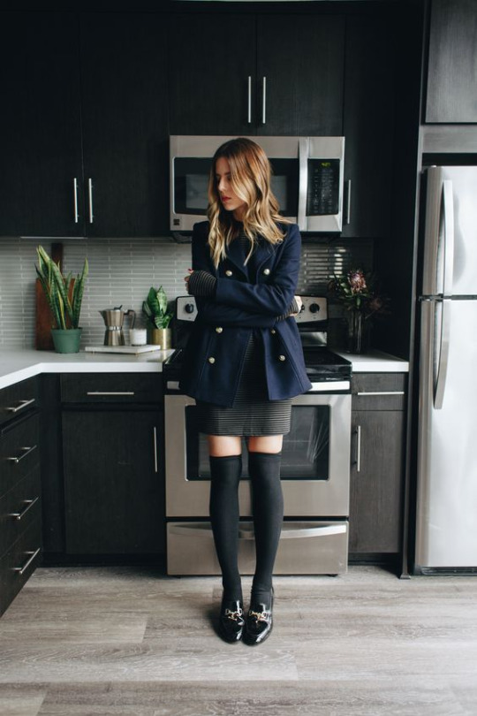 Dare to wear the military style this season! Michelle demonstrates just how striking this look can be, pairing a classic double breasted blazer with a mini dress and thigh high socks for a gorgeous retro style. Coat/Socks: Frame, Dress: Blella Luxx, Shoes: Kurt Geiger.