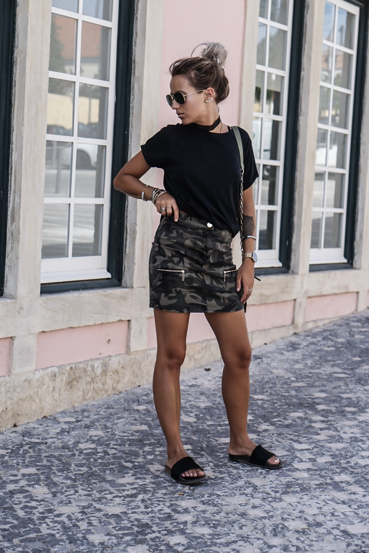 There are a hundred great ways to wear the mini skirt trend. Camille Callen is edgy and original in this camo print skirt with zip detailing, paired simply with a black tee and flats. Shirt: Mango, Skirt: Asos, Bag: Zara.