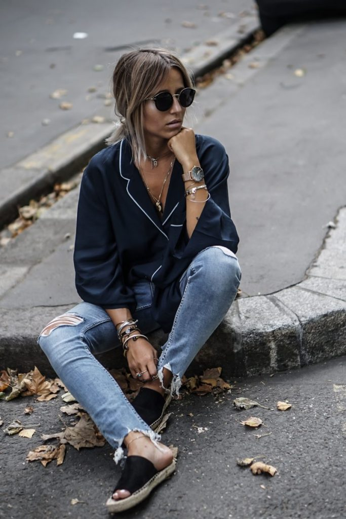 Camille Callen looks edgy and alternative in this pyjama style smock, worn with distressed jeans and a pair of retro shades. This style is perfected with silver jewellery and a simplistic watch. Jeans/Top: H&M, Shoes: Celine.