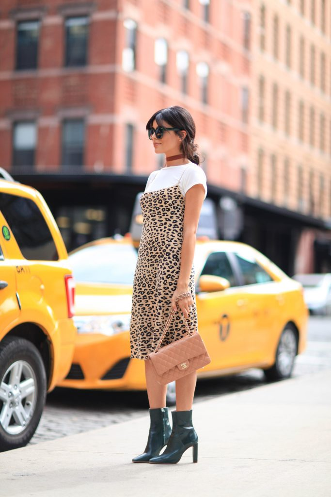 Sazan Barzani is rocking this leopard print slip dress, worn over a white tee and finished with a red choker. Try this look with heeled patent boots to steal Sazan's simple but authentic Autumn style. Dress: Kate Moss x Equipment, Tee: American Eagle. Boots: Zara, Sunglasses: Urban Outfitters, Bag: Vintage Chanel.
