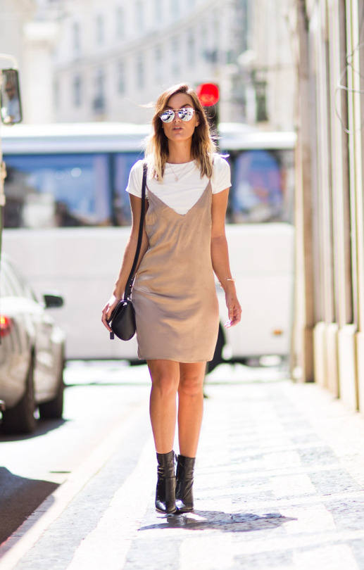 Wearing the slip dress trend in a neutral palette can really enhance the overall look. Anouska Proetta Branson is pretty in beige this fall, wearing a traditional style slip dress over a white tee for a classic casual style. Outfit: Missguided.