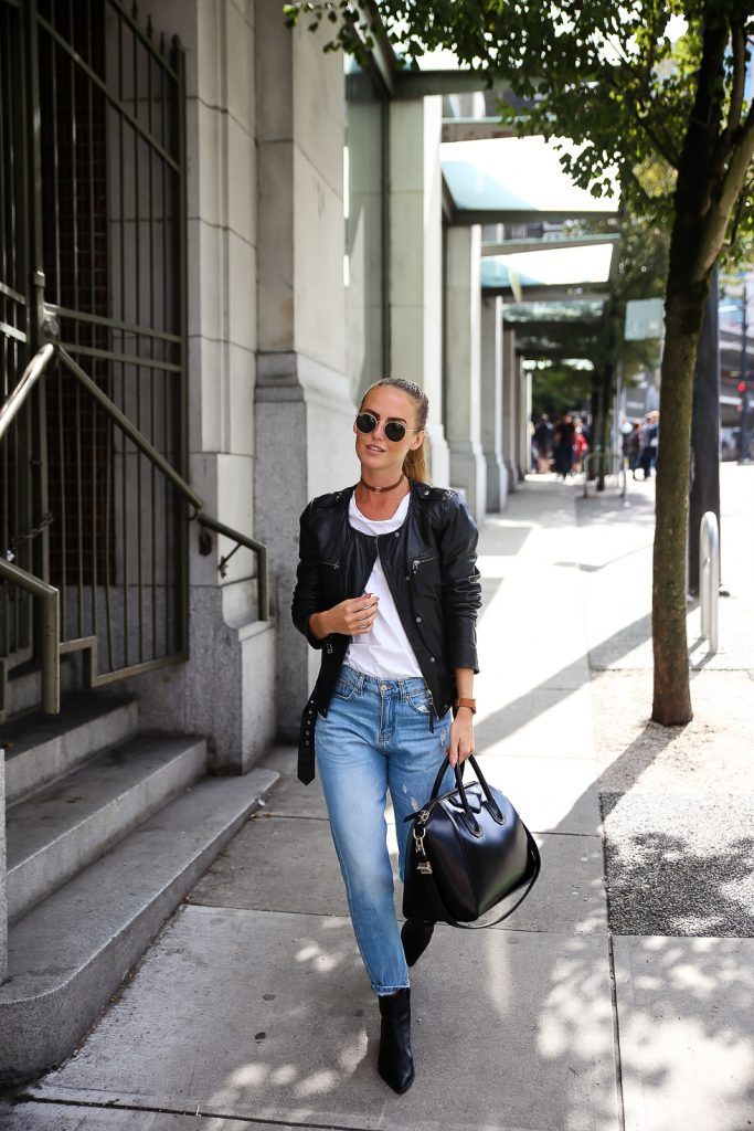 Jeans and a t-shirt aren't so simple with the inspired addition of leather. Kristin Sundberg rocks a sleek ponytail and even sleeker collarless leather jacket. Jeans: Chiquelle, T-shirt: Aplace, Jacket: Modström, Shoes: Jennie-Ellen, Bag: Givenchy, Choker: Na-kd, Sunglasses: Rayban