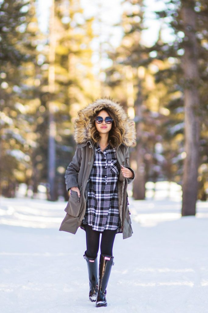 Stay warm and toasty by following Kim Le's oversized plaid shirt and furry parka look. The sunglasses and glossy Hunter Boots add just a touch of glam. Parka: ASOS, Plaid flannel dress: Morning Lavender, Leggings: Uniqlo, Boots: Hunter, Sunglasses: Nordstrom