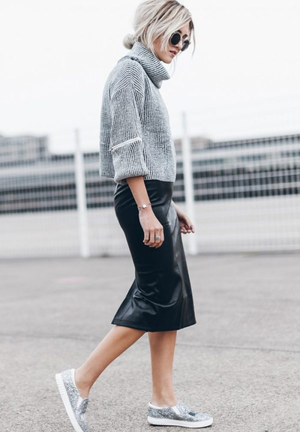 Jacqueline Mikuta embraces contemporary style with a chunky cropped sweater, leather midi skirt and sequined sneakers. Delicate metallic details play up the contrasting textures in this street-ready look. Sweater and Skirt: Verge Girl, Shoes: Sam Edelman, Sunglasses: ZeroUV