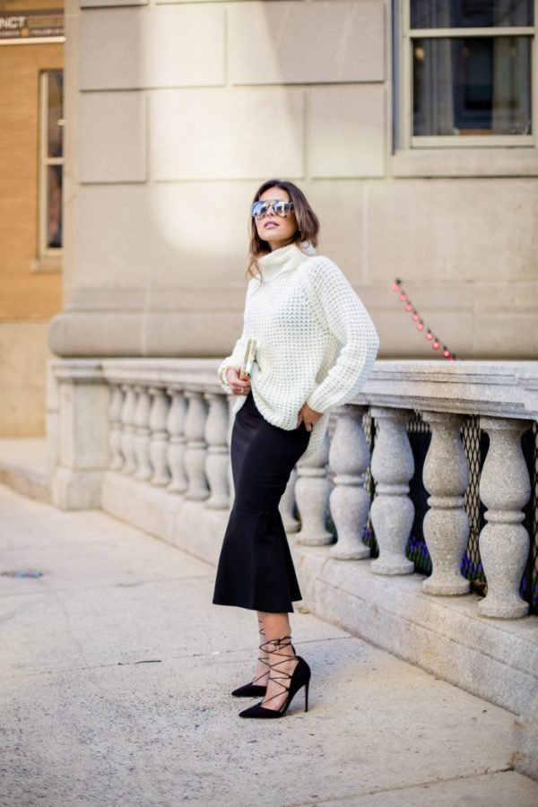 Pam Hetlinger looks like a million bucks in a creamy sweater and polished fit-and-flare skirt. She tops the look off with killer lace-up stilettos. Sweater and Skirt: Fashion Bunker, Shoes: ASOS, Sunglasses: Prada, Purse: Reiss