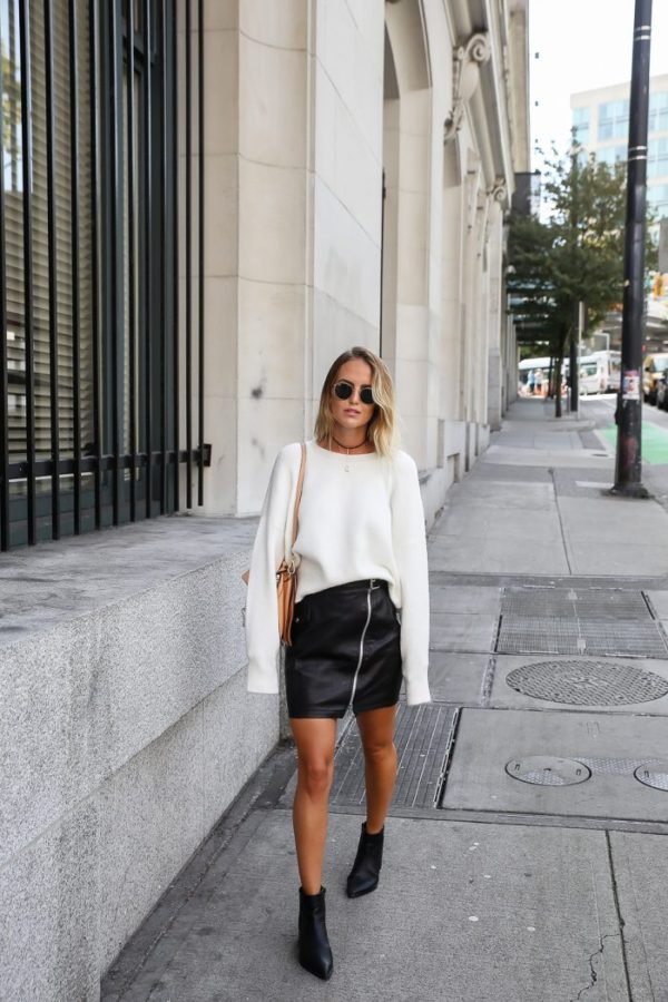 A vision in black and cream, Kirsten Sundberg dawns a zip leather skirt, retro sunglasses and an oversized knit sweater. Bare legs and high-heeled booties accentuate the edginess of her street style. Sweater: Chiquelle, Skirt: River Island, Boots: Jennie-ellen, Bag: Chloé, Sunglasses: Rayban, Necklace: Na-kd