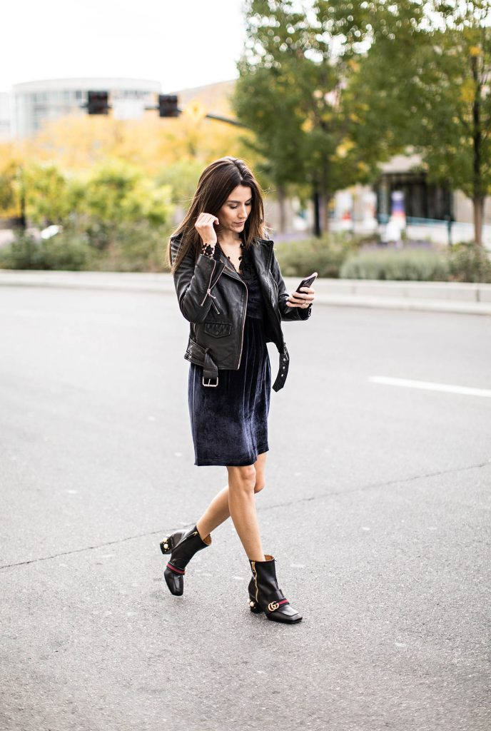 Christine Andrew is wearing this gorgeous velvet dress with a classic leather jacket to create an authentic rock chick style! We absolutely love this groundbreaking new trend. Dress: Saks Fifth Avenue.
