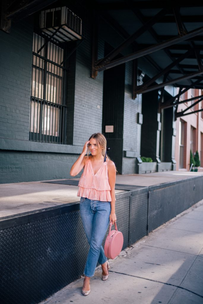 Julia Engel looks pretty in pink. She matches her layered velvet top with a chic leather bag. If you want to wear this look in winter then opt for black skinny jeans and a faux fur coat. Top: Apiece Apart, Shoes: Valentino, Jeans: La Vie Rebecca Taylor, Bag: Mansur Gavriel