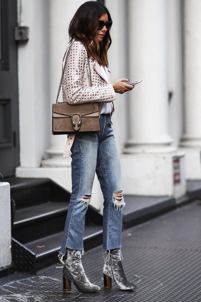 Erica Hoida turns up the glamour in theses stunning silver crushed velvet boots. She finishes her look of with of the moment distressed jeans and classic Gucci bag. Jacket: Nour Hammour, Top: AYR, Jeans: Mother, Boots: Public Desire, Bag: Gucci