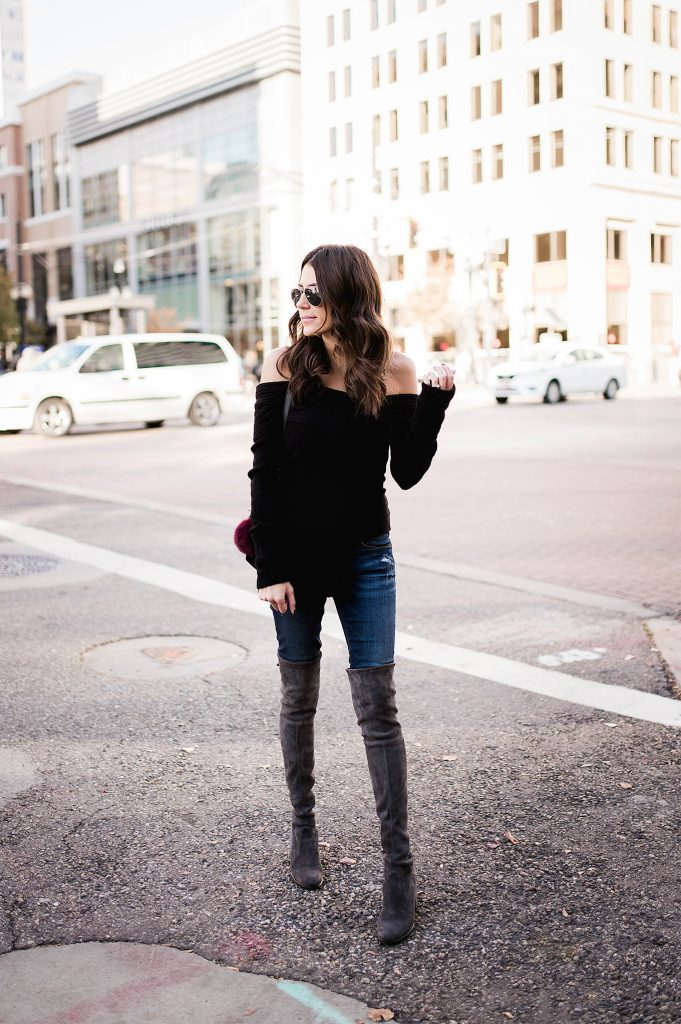 Christine Andrew looks stunning in this simple, refined style. Sleek over-the-knee boots, classic denim and cold shoulders accentuate her slim figure. Sweater, Jeans & Sunglasses: Ily Couture, Boots: Stuart Weitzman, Bag: M2Malletier