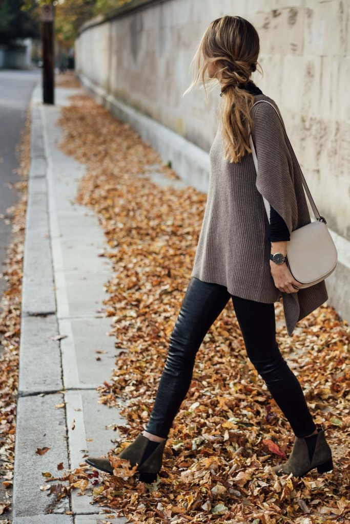 Jess Ann Kirby sports leather leggings with olive suede booties. This cashmere oatmeal-coloured cape is a beautiful and distinct piece for winter. Cape: Autumn Cashmere, Pants: Paige, Turtleneck: BP., Boots: Marc Fisher LTD, Watch: Larsson & Jennings, Bag: Coach 1941