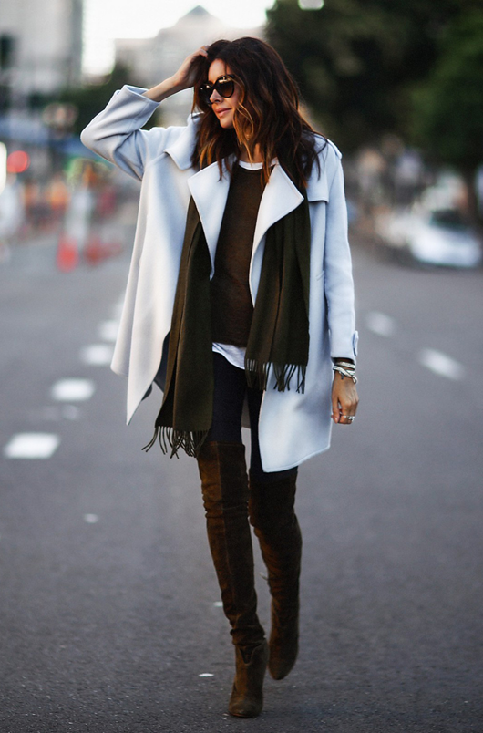 Deep earth tones provide a sensational contrast to this luxurious white cashmere coat. Abundant silver jewelry plays up the sophisticated boho vibe of this style. Via Erica Hoida Scarf and Coat: Burberry