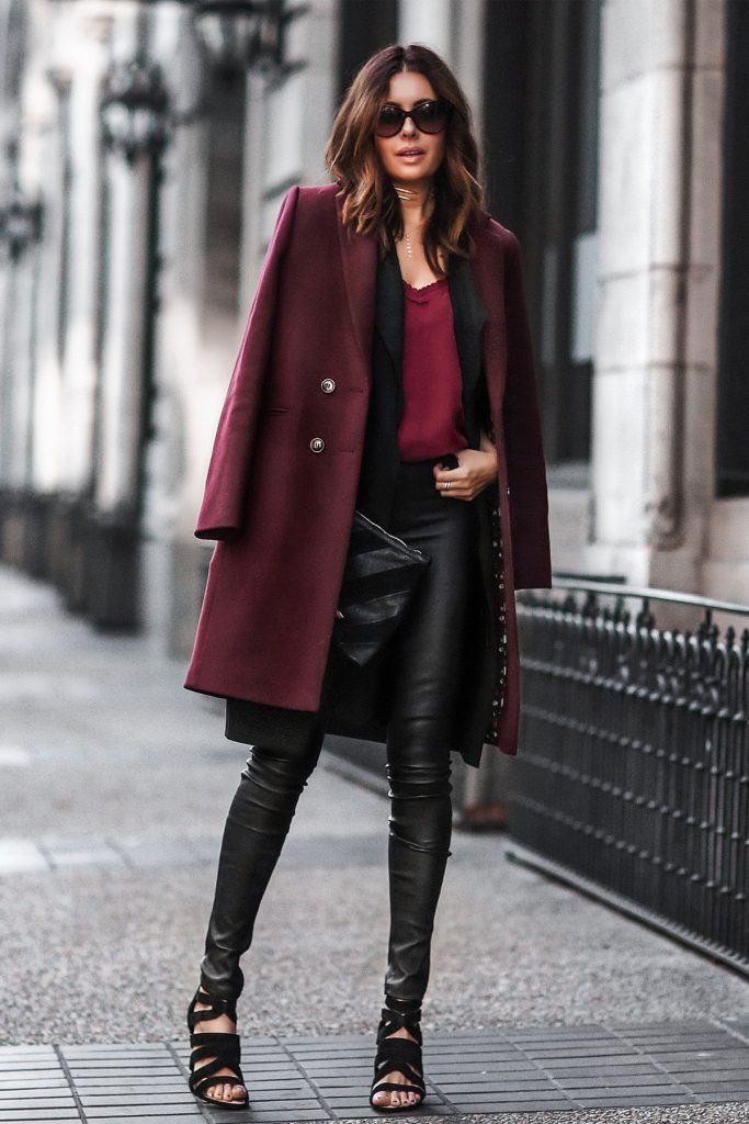 Erica Hoida rocks a classic winter colour scheme here, in a gorgeously rich plum overcoat and black leather leggings. This is a style which is ideal for everyday winter wear, as not only is it warm, but it also oozes glamour! Jacke/Camisolet: Sezane, Vest: Style Stalker, Pants: Helumt Lang, Shoes: Sole Society.