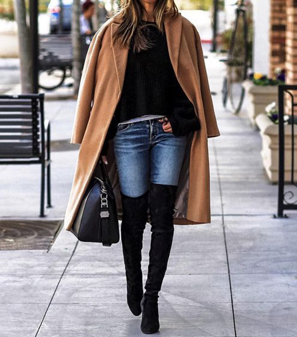 Sasha Simon keeps it casual in this gorgeously simple winter outfit, consisting of skinny jeans, a classic camel coat, and a pair of over the knee boots in a velvety style! Pair this look with a leather bag to steal Sasha's winter aesthetic. Brands not specified.
