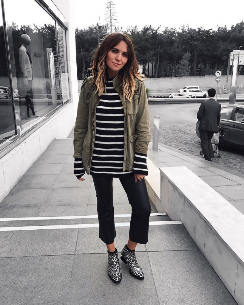 Moda Tutkusu rocks stripes and an army jacket. Cropped pants give this look a casual vibe that highlights her killer studded ankle boots. Jacket: Anine Bing