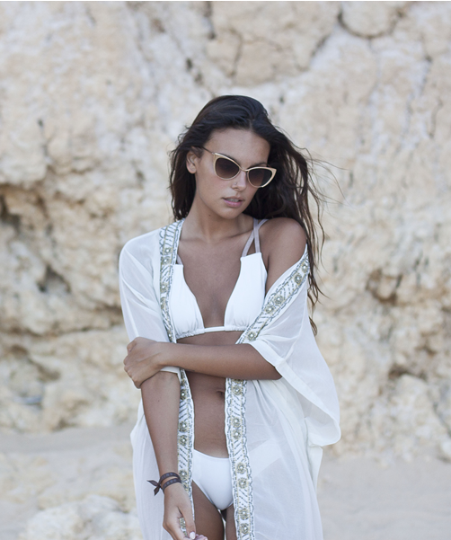 Mafalda Castro is wearing a white bikini from Latitid, Kimono from Primark and sunglasses from Zero UV