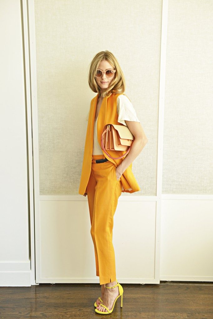 Olivia Palermo is wearing vintage sunglasses, suit from Paul & Joe, T-shirt from Daryl K, shoes from Stuart Weitzman and the bag is from Marni