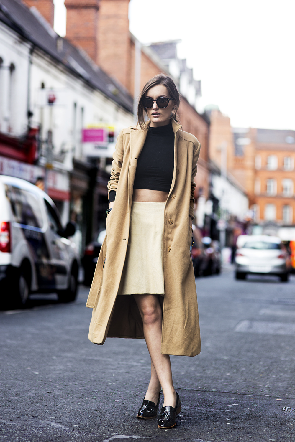 Anouska Proetta Branson is wearing a vintage camel coat, crop top from H&M, skirt from Folkstersuede, shoes from Office and sunglasses from Mink Pink