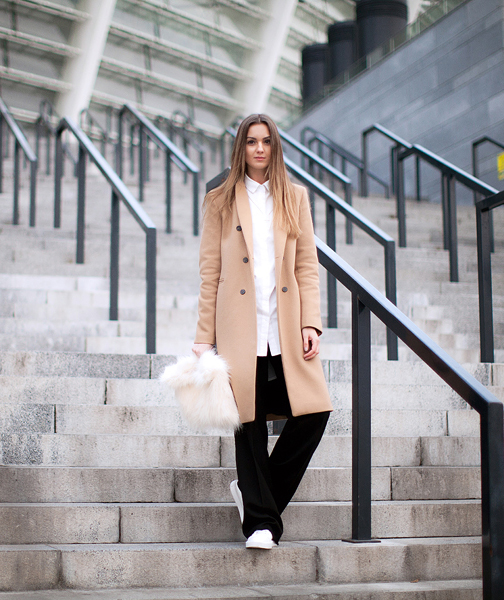 Nika Huk is wearing a classic camel coat from Zara