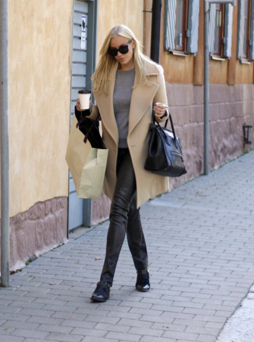 Petra Tungården is wearing a classic camel coat