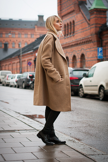 Charlotte Hellberg is wearing a camel coat from & Other Stories