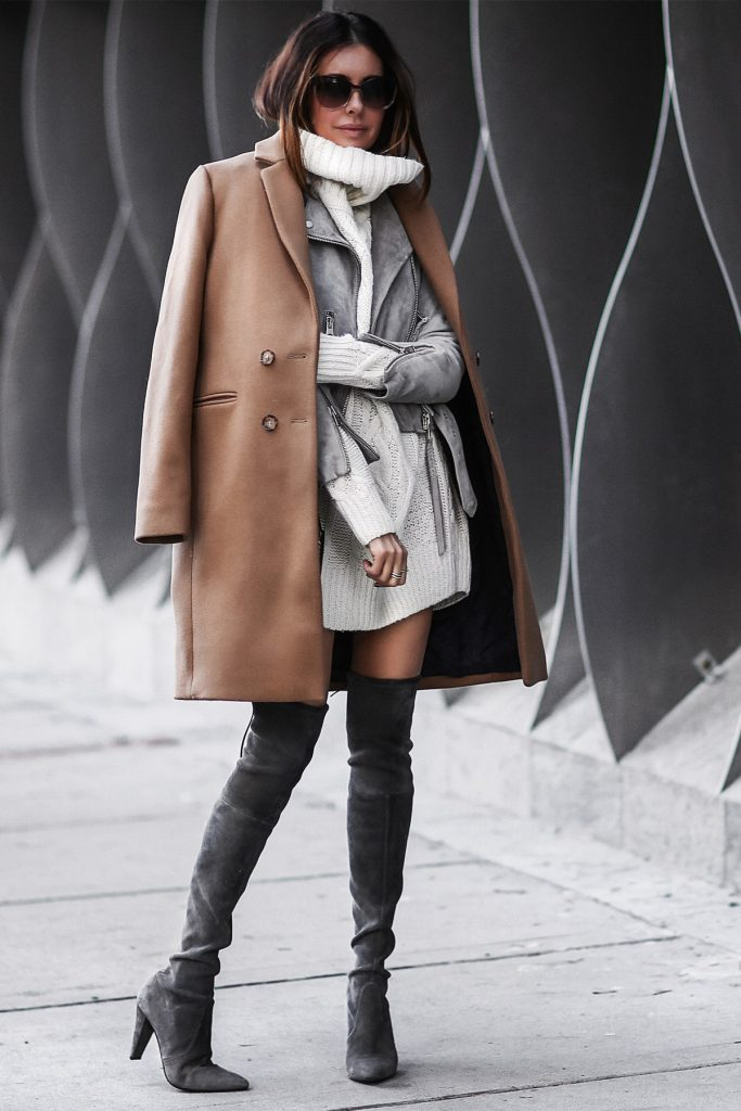 Erica Hoida is totally glam in this gorgeous winter style, consisting of thigh high suede boots, a matching suede jacket with belt detailing, and a classic camel overcoat. Give this look a try and be sure to achieve immediate sophistication! Coat: Sezane, Suede Jacket: AllSaints Sweater: Faith Connection, Boots: Stuart Weitzman, Bag: Chloe.