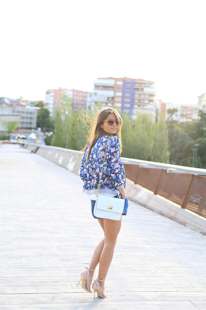 Seams For A Desire Is Wearing A Floral Bomber Jacket And Sandals From Suiteblanco, Shorts From Vero Moda And The Bag Is From The Code