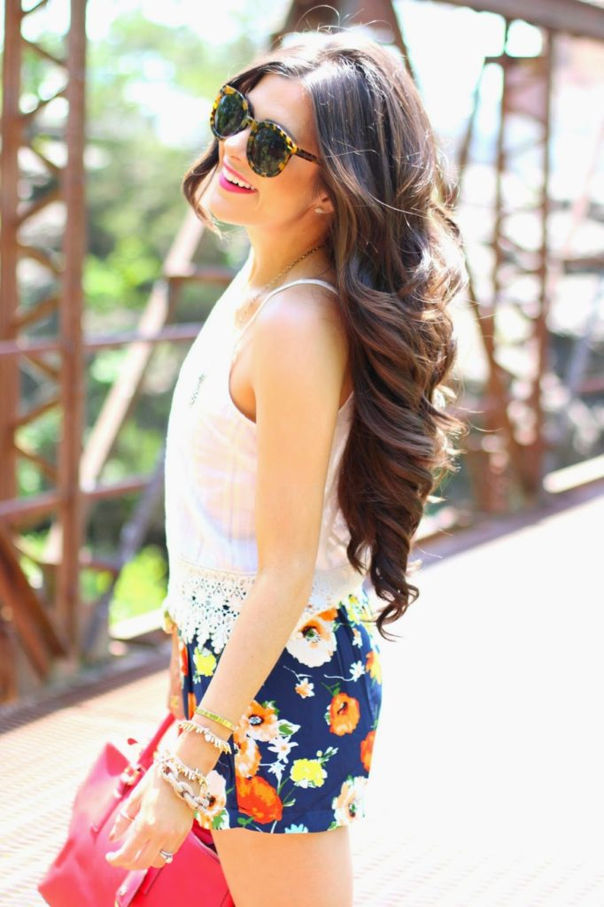 Emily Is Wearing Top And Floral Shorts From Belle Boutique And Sunglasses From Karen Walker