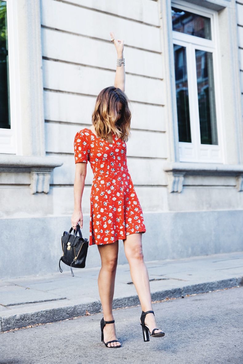 Collage Vintage is wearing a red floral dress from TopShop, shoes from Senso and the bag is from 3.1 Philip Lim