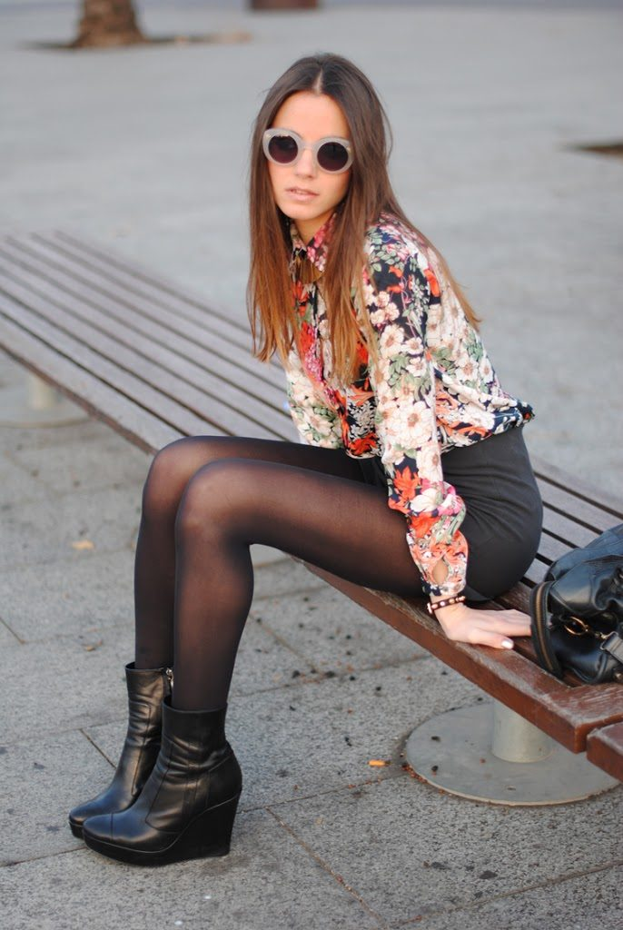 Zina Charkoplia is wearing a floral shirt from and shorts from Zara, boots from Ailanto, bag from Balenciaga and sunglasses from Emporio Armani