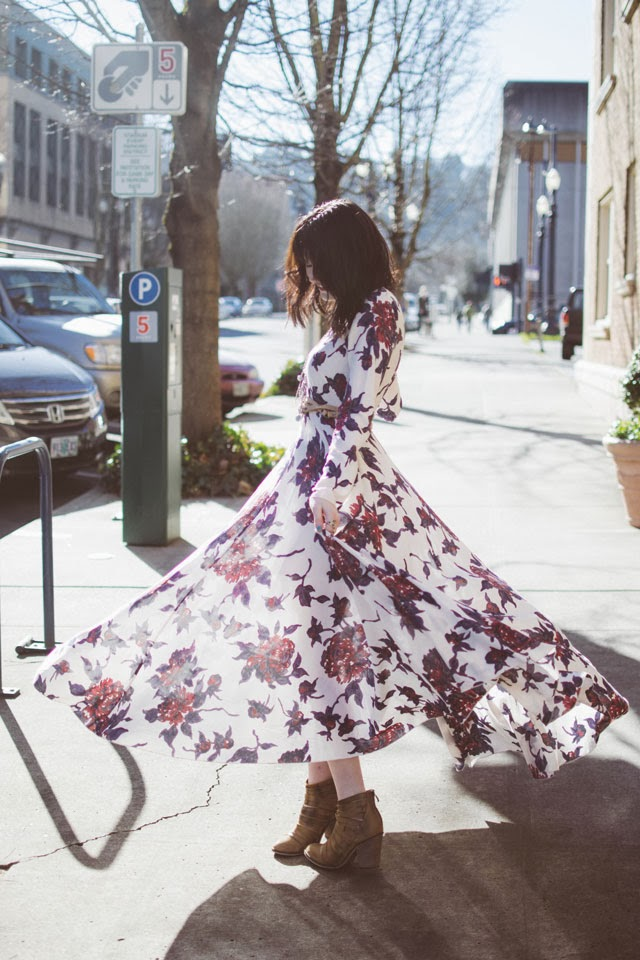 Kacie Cone is wearing a a floral First Kiss dress and hybrid heel boots from from Free People