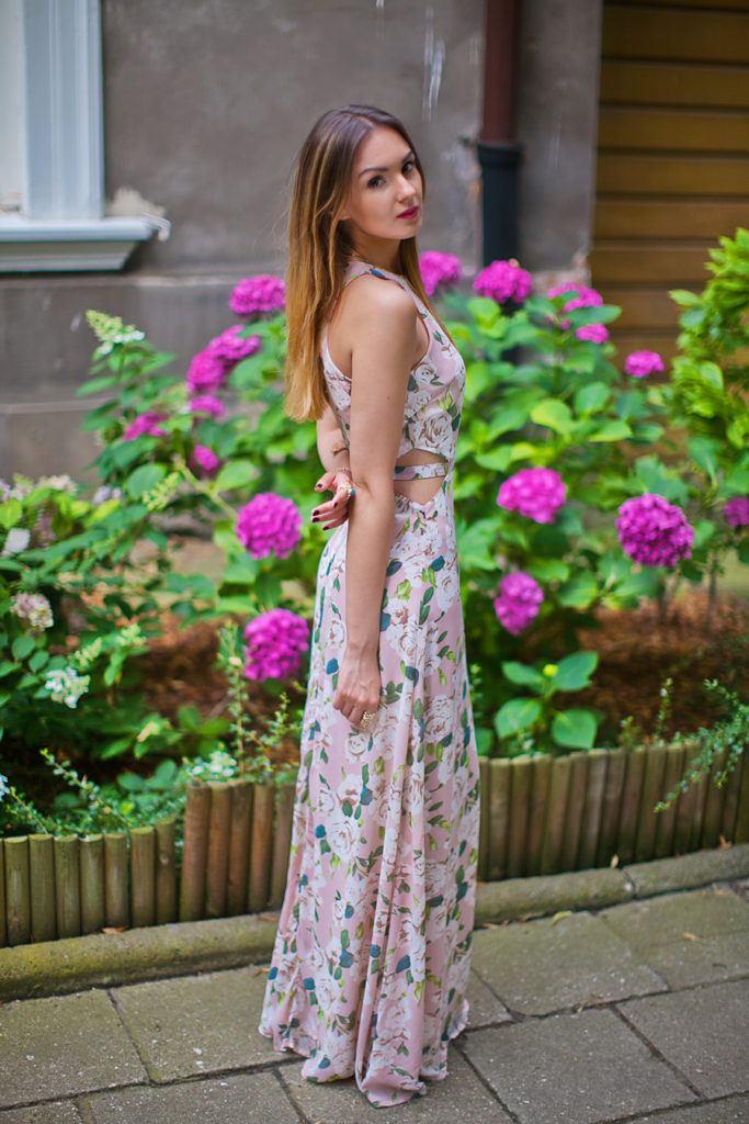 Nika Huk is wearing a floral dress from MissGuided