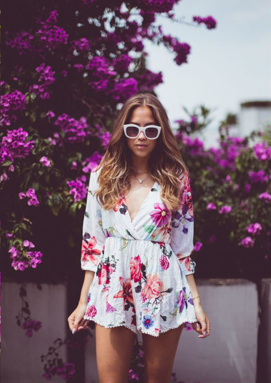 Kenza Zouiten is wearing a playsuit from Chicy and the sunglasses are from le Specs
