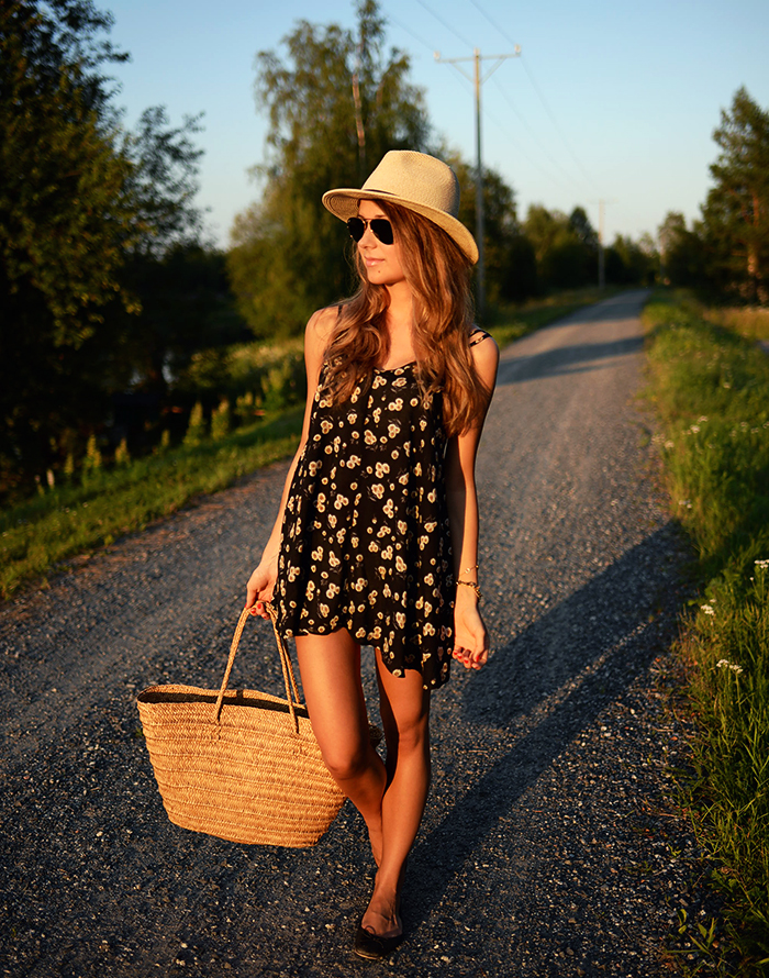 Marianna N. in a floral print dress from Florida, straw hat and bag