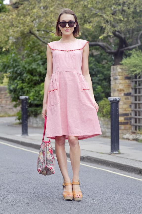 Ella Catliff is wearing a pink dress and a floral tote from Cath Kidston