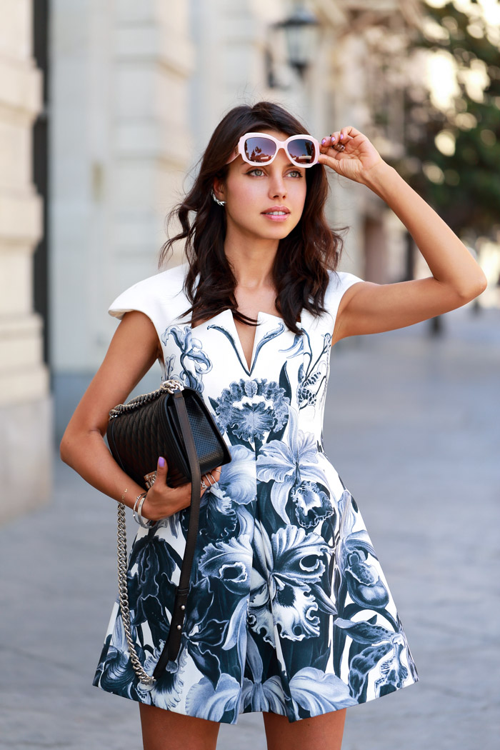 Annabelle Fleur is wearing black and white printed floral dress from Cameo, boy bag from Chanel and sunglasses from Tory Burch