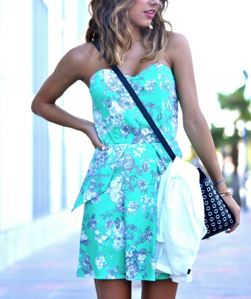 Just Coco is wearing a white shirt from Zara, floral dress from Dresslux and the bag is from Michael Kors