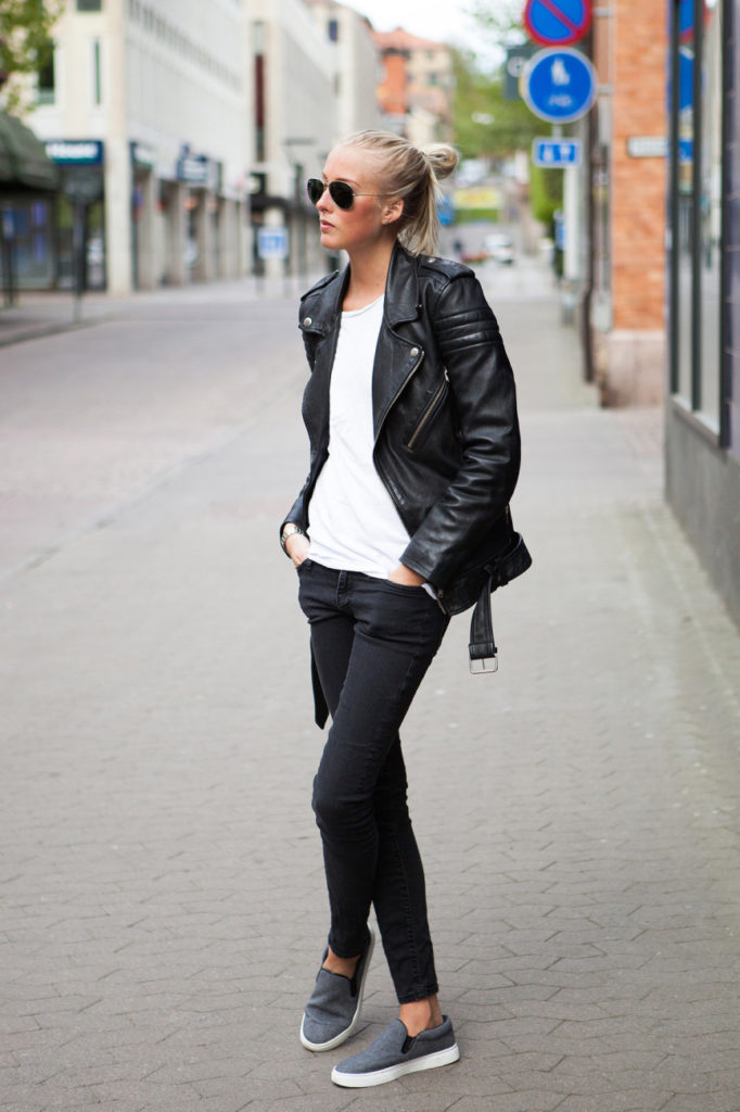 Ellen Claesson Is Wearing A Black Biker Leather Jacket From BLK Denim, WhiteT-Shirt From Bread & Boxers, Black Jeans from Crocker And Grey Slip-On's from Moss Copenhagen