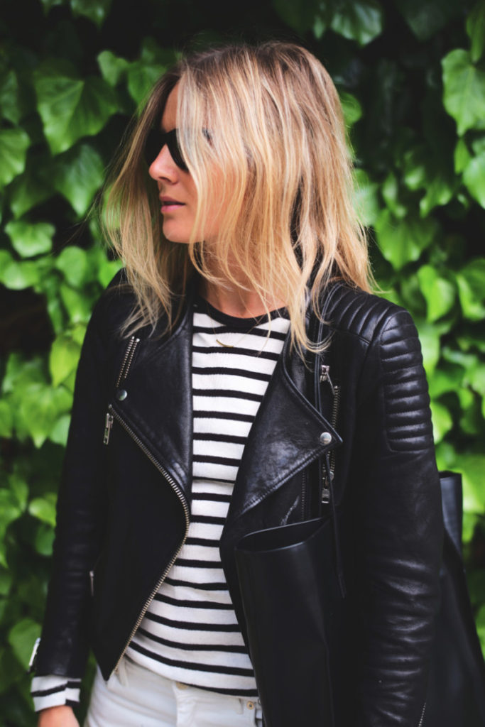 Lucy Williams is wearing a black and white striped top from Edith Miller and a black leather jacket from H&M