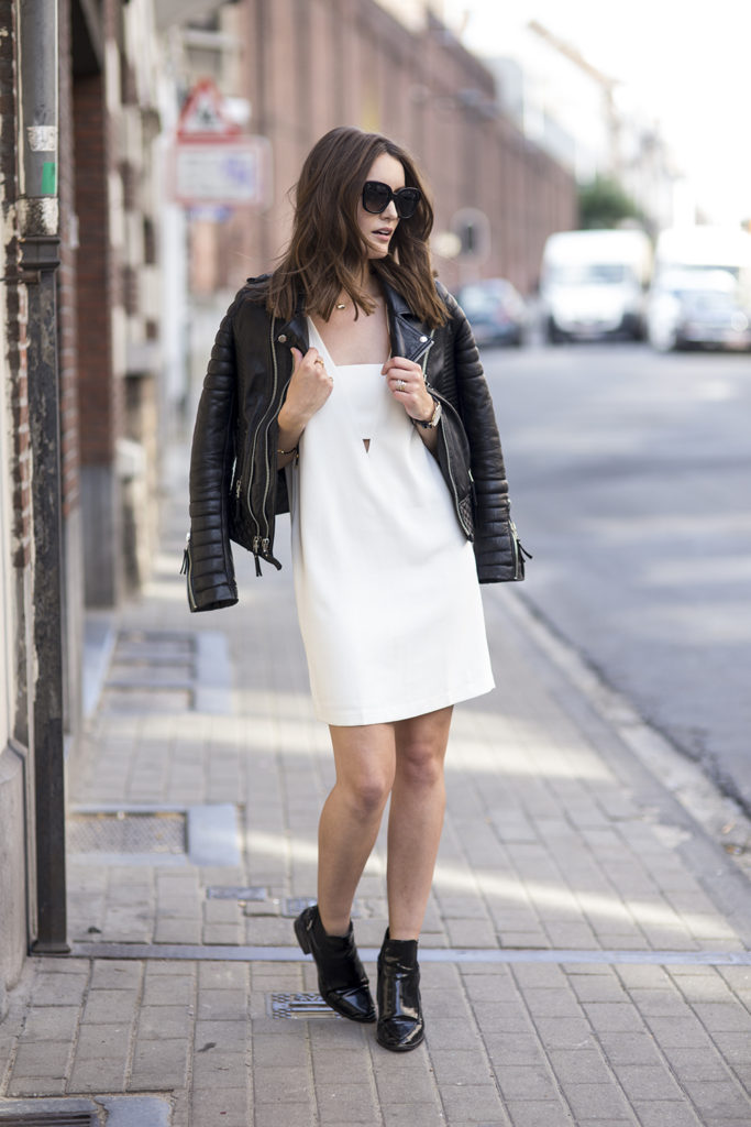 Anouska Proetta Brandon is wearing a black leather jacket from Boda Skins, white dress from Mango, sunglasses from Céline and boots from Zara