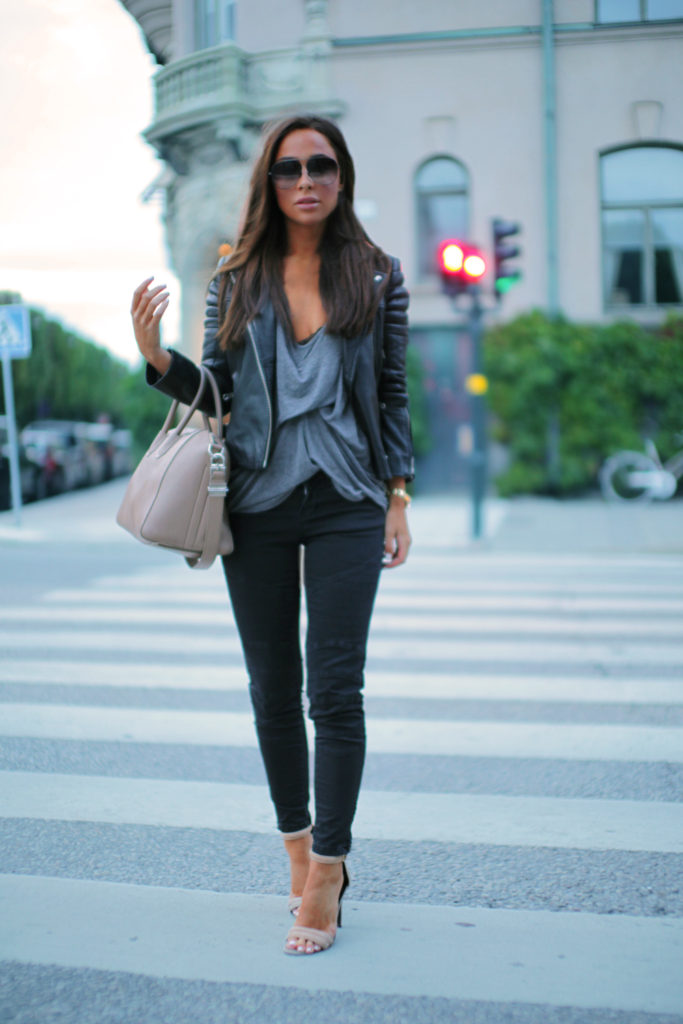 Johanna Olsson is wearing trousers from Lindes, shoes from Nicholas, bag from Givenchy, sunglasses from Dita, top from Riller & Fount and leather jacket from Whistles
