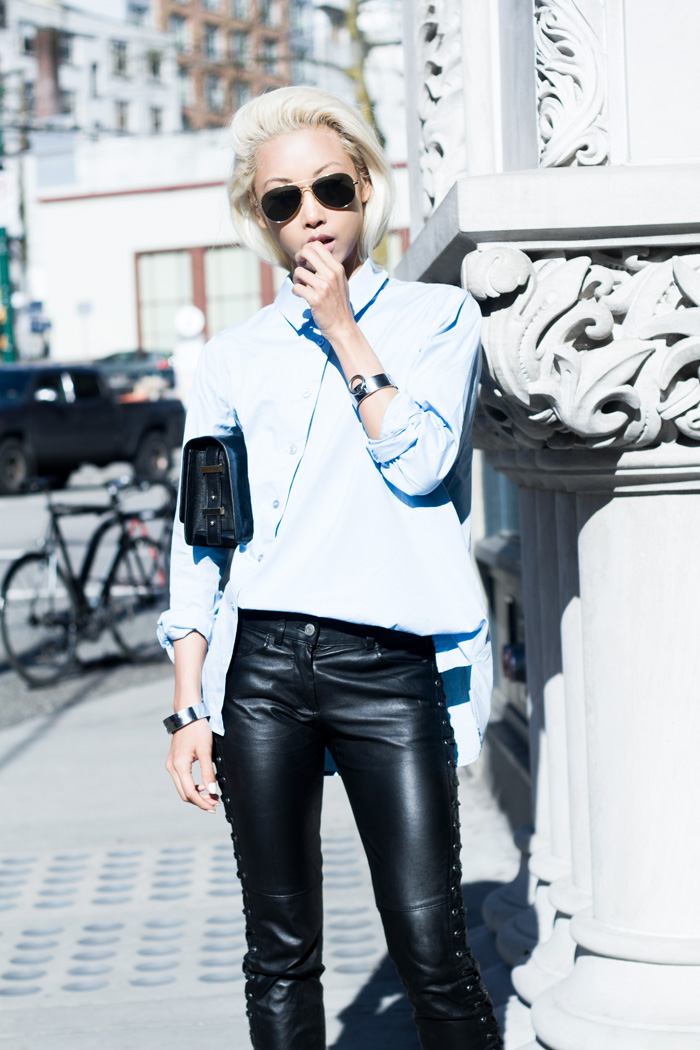 The Haute Pursuit Wearing Asymmetrical Shirt From Front Row, Isabel Marant Leather Trousers, And Rachael Ruddick Purse