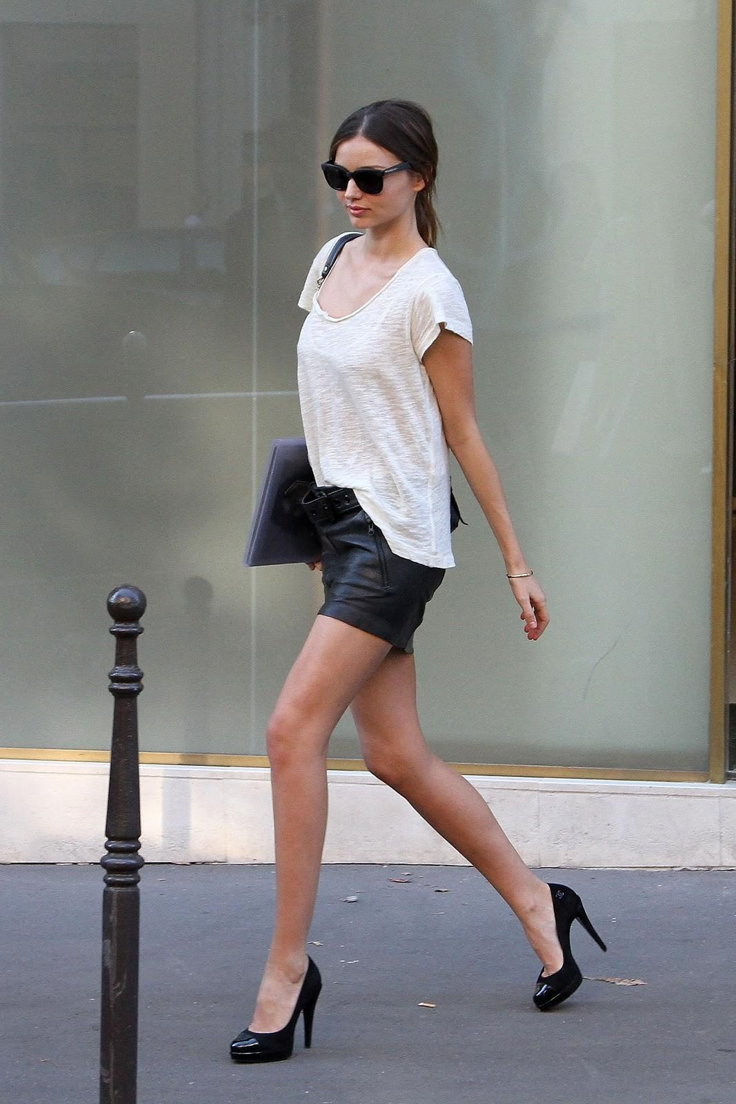 Street Style In Leather Mini Skirt And Low Neck Tee Miranda Kerr Shopping In Paris