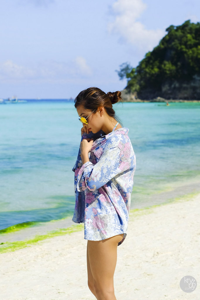 Kryz Uy Is Wearing A Floral Denim Polo From Guess, A Bikini From I Love Koi, And Mirrored Sunglasses