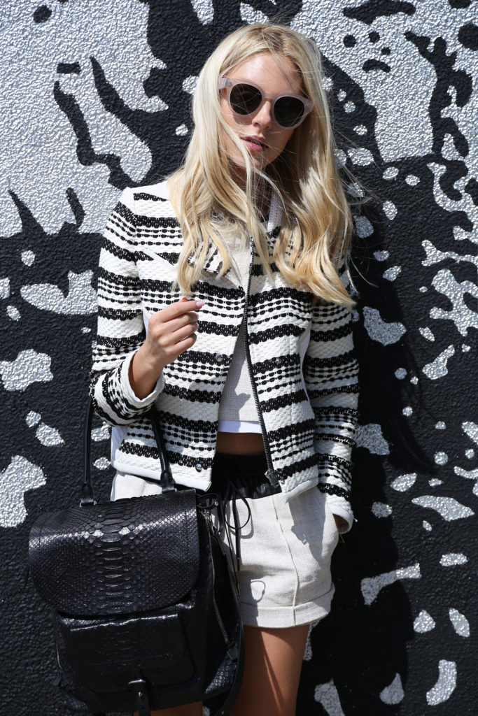 Peace Love Shea Is Wearing A Monochrome Outfit Consisting Of Top And Short From ALC, Jacket From IRO And Bag From Barbara Bui