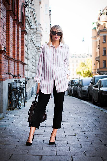 Charlotte Hellberg is wearing a vertical striped shirt from H&M, cropped black trousers from J. Crew, shoes and bag from Zara and the sunglasses from Karen Walker